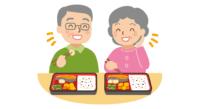 弁当を食べる高齢夫婦